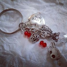 Check out this item in my Etsy shop https://www.etsy.com/listing/459740426/handmade-red-silver-keychain-i-love-you