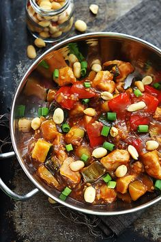 Slow Cooker Kung Pao Chicken (Feb 8, 2015). Easy & Yum. I doubled the sauce, used balsamic vinegar, 6 tbsp of soy sauce (vs. 8),  added 2 tsp of fresh grated ginger, & 3 tbsp Hoisin sauce, + more Sriracha & garlic. I added in chopped white onion same time as chicken. I added the cornstarch & water, & turned the heat to high & gave it 30min to thicken. Served with peanuts and green onion. Keeper.
