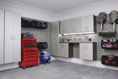 eclectic garage and shed by Flow Wall System  keeps everything off of the floor, also suggest LED battery powered lights so can easily find things during power outages