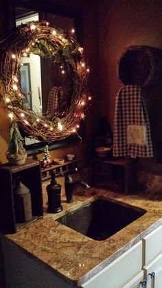Primitive Bathroom ~Love this- Grapevine wreath with white lights around, in fro. - Primitive Bathroom ~Love this- Grapevine wreath with white lights around, in front of the mirror, s - Primitive Homes, Primitive Bathrooms, Primitive Crafts, Primitive Christmas, Country Primitive, Country Christmas, Primitive Shelves, Primitive Snowmen, Christmas Christmas