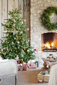 A stone fireplace keeps an elegant Christmas tree toasty on the covered patio of this Arizona home, furnished like a full-fledged living room.