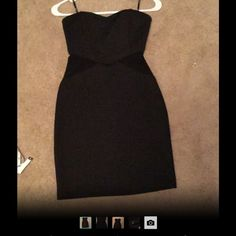 Little black strapless dress Form fitting little black dress. There are cut outs on the side that are mesh and see through. This dress stays up and doesn't fall down when worn (it has gel type material that grips your skin). Never worn besides trying it on! Forever 21 Dresses Strapless