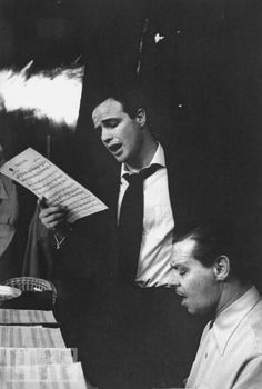 Actor Marlon Brando reading music and singing along with unidentified accompanist playing the piano during filming of Guys and Dolls. Get premium, high resolution news photos at Getty Images Golden Age Of Hollywood, Old Hollywood, Marlon Brando The Godfather, Jack Palance, Jean Simmons, Reading Music, Guys And Dolls, Most Beautiful People, Classic Image