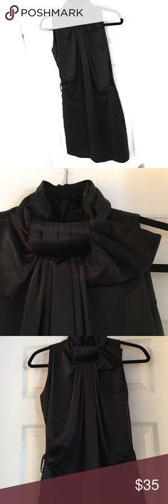 Silk BCBG MAXAZRIA Dress Elegant, flowing black dress. 100% silk. Gorgeous and unique details. I'm moving so all is going! BCBGMaxAzria Dresses Midi