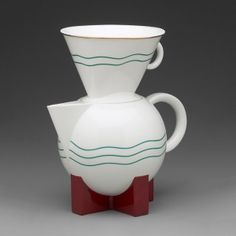 Michael Graves (American, 1934–2015), designer  Swid Powell (American, founded 1982), retailer The Big Dripper Coffeepot and Filter, 1987 Porcelain, red-brown and blue-green enamel, gilding Yale University Art Gallery, Gift of Lindsay S. Suter, M. Arch. 1991, 2001.46.1a-c
