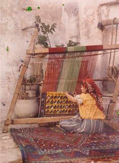 "Autochrome photograph Algeria: Shot as early as 1909, the image below shows a traditional weaving destined for the tourist trade—it spells out the word ""souvenir."""
