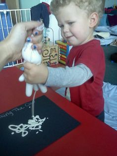 Milking a cow:rubber glove and white paint