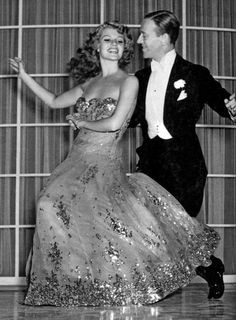 Rita Hayworth and Fred Astaire dancing.