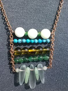 """Copper chain with misc. green ladder. 14"""". G332. $20.00"""