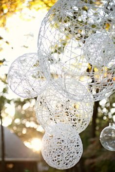 String globes - White PVA Glue, Balloons and string... GO! Should hold up when hanging outside!