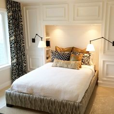 love this built in headboard/nook with molding details and the hidden storage