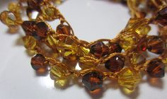 Beaded Crochet Bracelet Wrap, Necklace, Brown and Gold Bi-cone Beads on Gold Nylon Thread Free Shipping via Etsy If you need crochet patterns: https://www.etsy.com/shop/Patternstriedandtrue If you need crochet tips: http://patternstriedantrue.wordpress.com