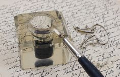 Stock image of 'vintage background with retro ink pen on old aged handwriteln letter'