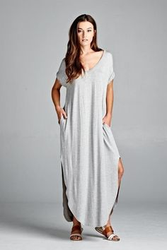 Loose Fitting t-shirt dress. Loose fitting with lightly rolled sleeves, side pockets and open side slits. RAYON SPANDEX Runs Large Hand Wash Made in the USA Oversized T Shirt Dress, Grey Maxi, Maxi Shirt Dress, Maxi Dresses, Look Chic, Heather Grey, Short Sleeve Dresses, My Style, How To Wear
