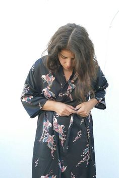 Black Japanese Kimono Robe with floral pattern will fit any occasion. The floral black kimono style dress is elegant, comfortable, unique and beautiful. The satin fabric is nice. One of a kind. Kimono cardigan is super trendy, dont wait for it to end :)  - Made from Satin fabric - One Size - One of a kind - Comes with a waist rob - Made in Israel  Approx measurements in cm:  One size chest: 112cm Waist: 98cm Back/Front length from waist: 80cm  Notice the model is a bit shorter than avera...