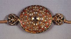 Armlet, Rajasthan, 19th cent. AD  A decorative and ornamental armlet with kundan gold work inset with diamonds. Note the brilliant red ename...