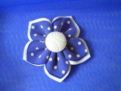 Cute flower you can hot glue onto a hair clip, wall art, or???