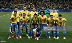 Brazil's team poses before the 2018 FIFA World Cup qualifier football match against Paraguay in Sao Paulo, Brazil on March 28, 2017. / AFP PHOTO / Miguel SCHINCARIOL