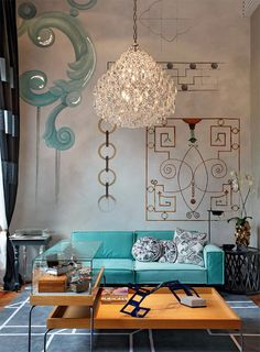 .Eclectic and gorgeous - love the personalized wall drawings, colour palette and 'shut the front door' chandelier....well chosen elements all cleverly conceived.