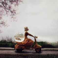 """An image that took a few months to complete earned photographer Kylli Sparre a win in the Enhanced category in the Open Competition. The photograph titled """"Rescue operation"""" sets the scene of a daydream about a getaway -- a story with an open ending. Capturing the photo was no easy feat: """"The fishbowl got rather heavy when we filled it with water and we almost fell with it on the slippery rocks when trying to carry it up from the shore. Luckily no one got hurt and the fishbowl is still in…"""