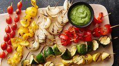 Easy pesto aioli plus fresh veggies equals super-delicious kabobs! These beauties are fancy enough for summer parties but simple enough for meatless Mondays.
