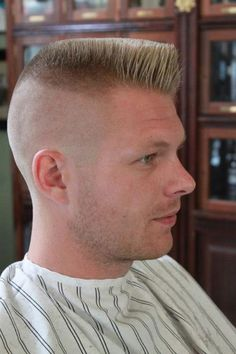 The mens Flat Top haircut is a men's hairstyle that is most associated with the military or a Guile character of the Street Fighter game. Some of the most notable individuals who have worn the flat top look are footballer Howie Long, American Idol judge Simon Cowell, provoking Grace Jones, American wrestler Brock Lesnar.