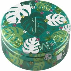Picture a lush tropical forest, and you can almost hear the gentle rain dripping from one leaf to another. This tin features the Monstera delicosa, the giant cheeseplant, and sits nicely by your houseplants.