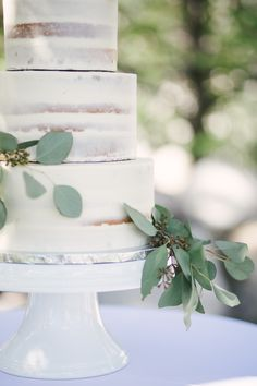 Simple greens to decorate your white wedding cake with a crumb coat of frosting. The nearly naked wedding cake or semi-naked wedding cake look.