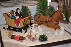 National Gingerbread Competition, Asheville, NC. An equestrian Christmas, horse and sleigh.