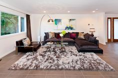 chic living room in browns with leather sectional couch