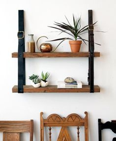 DIY Leather & Wood Bookshelf Re-purpose a couple of rugged leather belts and a few wooden planks to create this stunning bookshelf.