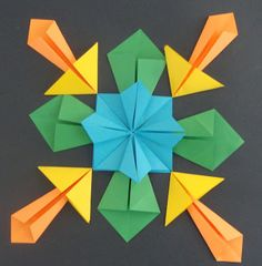 """Materials:  - Origami Paper/ I actually bought colored paper from Office Depot and cut 5"""" x 5"""" square pieces  - Glue  - 18"""" x 18"""" Constructi..."""