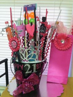 21st birthday gift bucket I did for my best friend!! Consists of a birthday slash, tiara, birthday button, miniatures, shot glasses, beer bong balls, and some random decorations.
