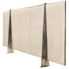 Ateliers Jean Prouvé Screen, French, 1950s. Steel with polished and painted finishes.