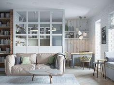 Une séparation vitrée encadrée de bois dans le séjour