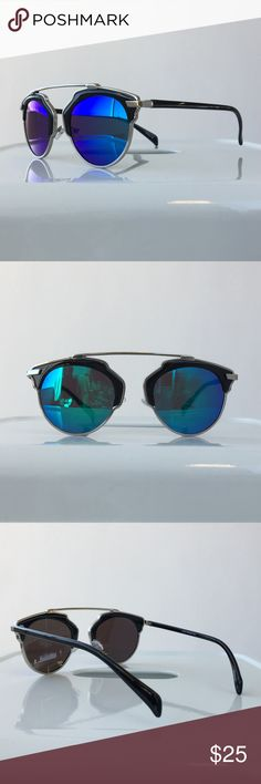 """Blue Mirrored Black Cateye Statement Sunglasses Black and blue mirrored statement cat eye sunglasses with """"rimless"""" design. Color of lenses changes based on what angle you look at it. Approximately 6"""" X 2.0"""". UVA & UVB protection. Brand new. Please carefully review each photo before purchase as they are the best descriptors of the item. My price is firm. No trades. First come, first served. Thank you! :) Accessories Sunglasses"""