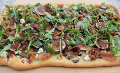 flatbread with figs, goat cheese and prosciutto. Maybe with rosemary instead of arugula