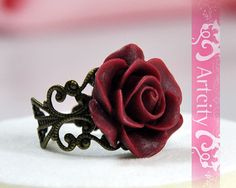 Hey, I found this really awesome Etsy listing at http://www.etsy.com/listing/83845827/vintage-style-resin-red-rose-flower