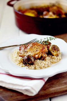 Lemony and bright, this recipe for Braised Lemon Chicken Thighs is a perfect weeknight or entertaining meal! from