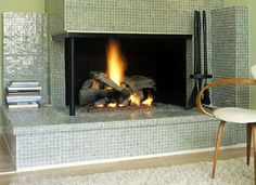 The shape and fire say fireplace, but the tile says municipal pool dressing room. And I kind of love it. Modern Fireplace Tiles, Tile Fireplace, Fireplace Surrounds, Dream Rooms, Recycled Glass, Midcentury Modern, Backsplash, Clear Glass, Luxury Homes