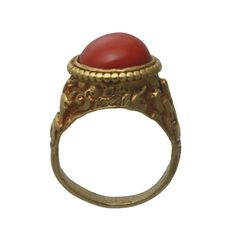 A Gold and Coral Ring, Tibet 19th Century www.ollemans.com