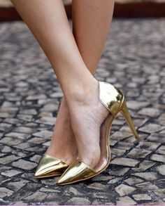 Clear pumps with golden toe caps and heels.