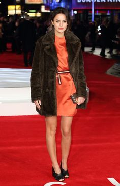 Pin for Later: All the Made in Chelsea Girls' Finest Fashion Moments  Lucy kept warm in a brown faux-fur coat at the Focus screening in London, but her orange dress added a little sunshine to the final look.