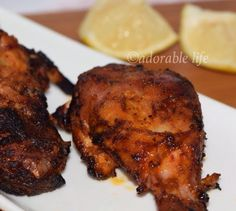 Homemade Indian Tandoori chicken on stove top BBQ Grill