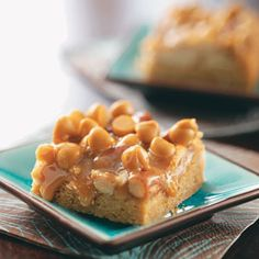 Gooey Butterscotch Bars Recipe -The name says it all for these bars. With caramels, butterscotch chips and pudding, they're ooey, gooey and finger-lickin' good! Sugar cookie mix speeds up prep time during the busy holidays, and the easy recipe makes a big batch! —Carol Brewer, Fairborn, Ohio