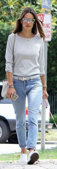 Who made  Alessandra Ambrosio's sunglasses, white belt, Iphone case, sneakers, and blue jeans?