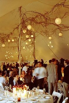 Bring the outside inside by using tree branches and twigs inside your marquee