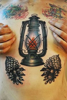 Well done Lantern and pine cones!! Great traditional work by Jason Grace at Idle Hand Tattoo Shop