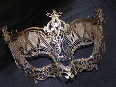Gold and silver metal filigree masquerade mask with crystal accents