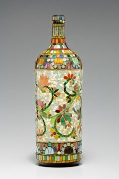 mosaic wine bottle, cut up old CD or DVDs and spray paint, glue on bottle, add finish coat.